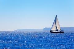 Blue Mediterranean sailboat sailing Royalty Free Stock Image