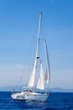 Blue Mediterranean sailboat sailing Stock Image