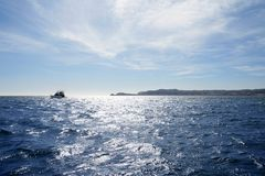 Blue Mediterranean sea with fishing boat Stock Image