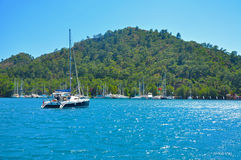 Blue Mediterranean sea with mountains and yachts Royalty Free Stock Photos