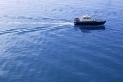 Blue Mediterranean Sea with pilots boat Royalty Free Stock Images