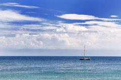 Blue Mediterranean sea, sky and clouds in a summer day in Apulia, Italy Stock Photos