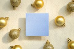 Blue memo pad, sticky note with christmas decoration gold baubles on fabric background. Blue memo pad, sticky note with christmas decoration gold baubles on stock photography