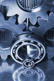 Blue menagerie of metal. Cogs, gear, ball-bearings against steel in blue Stock Photos
