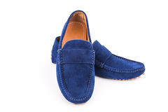 Blue mens suede leather loafers pair isolated on white backgroun Royalty Free Stock Photography