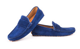 Blue mens suede leather loafers pair isolated on white backgroun Royalty Free Stock Photo