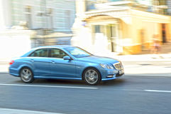 Blue Mercedes driving on the streets of Moscow to rate Stock Photo