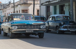 Blue merican vintage car drives in the province Villa Clara in Cuba on the street Royalty Free Stock Photography