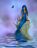Blue Mermaid Sitting Stock Image