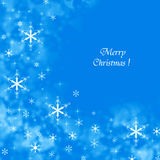 Blue Merry Christmas background with snowflakes Stock Photography
