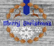 Blue Merry Christmas on wooden background with snowflake Stock Photo