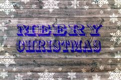 Blue Merry Christmas writen on wooden board with snoflake royalty free illustration