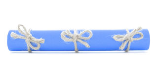 Blue message tube tied with rope, three natural bows isolated Royalty Free Stock Image