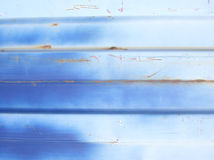 Blue Metal Abstract. This is the side of a big truck, badly painted and starting to rust where it's been scratched up. Interesting for backgrounds and textures Royalty Free Stock Image