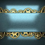Blue metal background with cogwheel gears Stock Photos