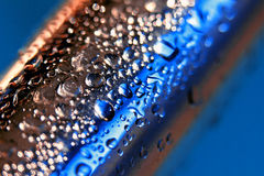 Blue Metal Bar. Macro image of a metallic water coated bar Stock Photography
