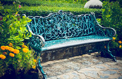 Blue metal bench in beautiful thai park Royalty Free Stock Photos