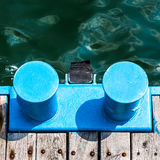 Blue metal bollard marina Stock Photo