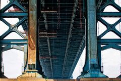 Blue Metal Bridge in Low Angle Photo at Daytime Royalty Free Stock Photos