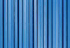 Blue metal corrugated fence with vertical bars Royalty Free Stock Photo