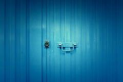 Blue metal door Stock Photos