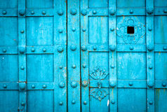 Blue metal door gate texture witn checkered pattern Royalty Free Stock Photo