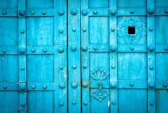Blue metal door gate texture witn checkered pattern Royalty Free Stock Photo