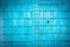 Blue metal door gate texture witn checkered pattern Royalty Free Stock Photos