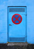 Blue Metal Door with No Stopping Sign Stock Photography