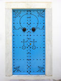 Blue metal door in Sidi Bou Said in Tunisia Royalty Free Stock Photo