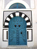 Blue metal door in Sidi Bou Said in Tunisia Stock Image