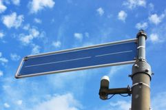 Blue, metal, empty street sign with cloudy sky Royalty Free Stock Images