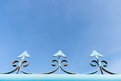 Blue metal fence with clear sky Stock Image