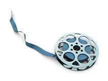 Blue metal flm reel. 3d illustration of metal film reel with blue film, over white background Stock Images