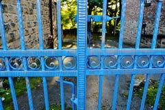 Blue metal gate gold tips swirl Royalty Free Stock Image