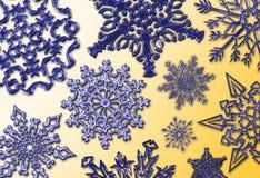 Blue Metal on Gold. Shiny blue metallic snowflakes on gradient gold Stock Photos