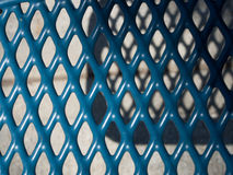 Blue metal grill with shadows-5022225 Stock Photography