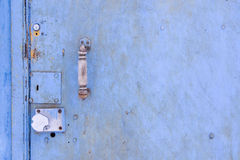 Blue metal grunge texture with handle and doorlocks Stock Images