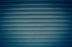 Blue metal roller shutter. Blue metal industrial roller shutter Stock Image