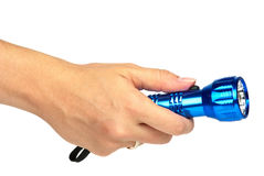 Blue metal LED flashlight in hand Royalty Free Stock Image