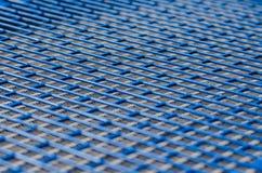 Blue metal mesh texture with rectangular holes Stock Photos