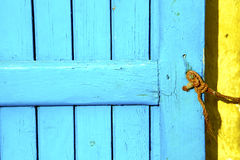 Blue metal rusty  brown    morocco in yellow rope Royalty Free Stock Photos