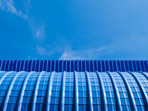 Blue metal sheet and blue sky Royalty Free Stock Images