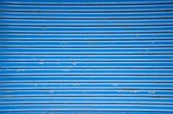 Blue metal shop door background Stock Images