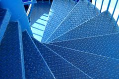 Blue metal spiral staircase.  Stock Image