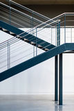 Blue metal staircase. Interior warehouse stairs. Stock Photography