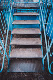 Blue metal stairs. In the old abandoned amusement park stock images