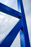 Blue metal support construction. On the metal wall background Stock Photography