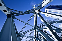 Blue metal suspended bridge. Construction Royalty Free Stock Photo