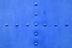 Blue metal textured background with rivets Royalty Free Stock Photos